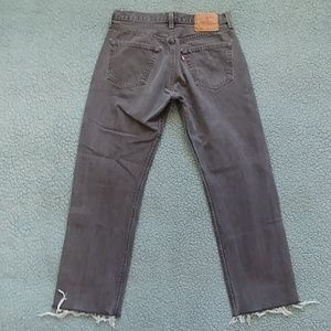 Cropped faded black levis 501s made in USA